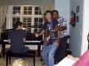 DOc & DARYL DAVIS sharing a guitar, ARI BORGER on the piano at 2011 Cincy Blues Fest Piano Party